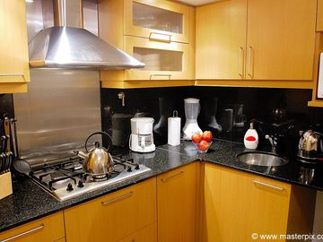 Kitchen features stove top, fridge/freezer, microwave, juicer, blender, & more!