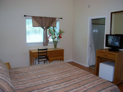 Pahoa house rental - Pool View Master Bedroom w/ walk in closet, HDTV/DVD, Alarm Clock Radio/ Minifr