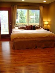Girdwood lodge photo - Bedroom with king bed off of large deck