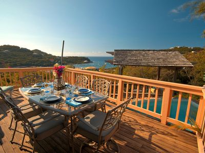 Alfresco dining on the patio deck with expansive views of the Caribbean Sea