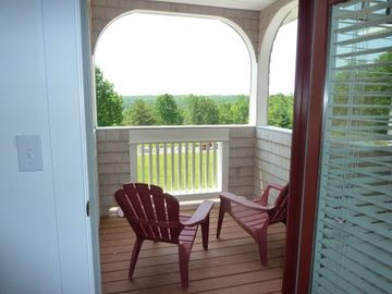 Looking out of second floor bedroom with views of Blue Hill Bay to the left.