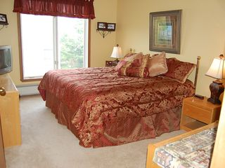Mount Snow condo photo - Master Bedroom with large closet and full bath + TV