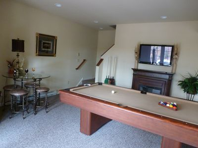Additional game table and electric fireplace.