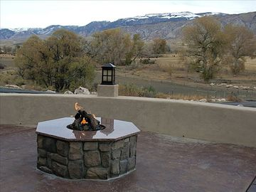 Fire-pit in lower terrace. View to northeast of Big Horn Mountains.