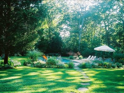 Lovely lush gardens surrounding sparkling pool