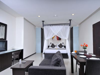 Fully Furnished room with kitchenette & dining table