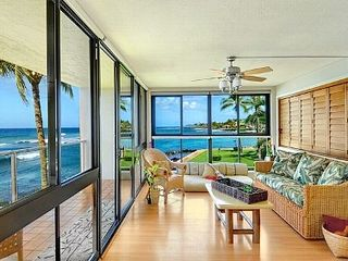 Poipu condo photo - Surf Song corner unit with 2 walls of glass on the surf. BR windows face west