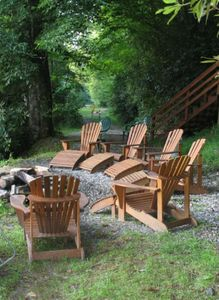 The firepit and adirondack chairs make for an awesome outdoor event.
