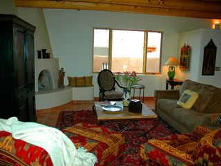 Taos house photo - Spacious living room with Kiva Fireplace. Flat Screen, TV, DVD and WiFi