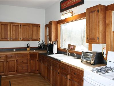Custom appointed Cherry kitchen with honed granite counter. Micro and Keurig.