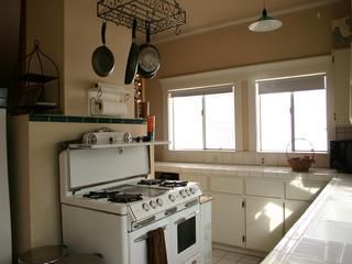 Full kitchen with dishwasher, grill, microwave, coffee maker and coffee/teas