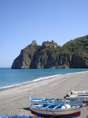 Taormina apartment photo - Sant'Alessio castle (visible form the terrace) and local fishing boats