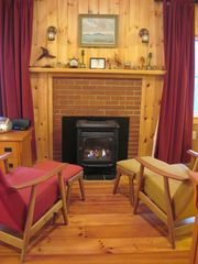 Hancock cabin photo - Gas fireplace with 2 comfy chairs