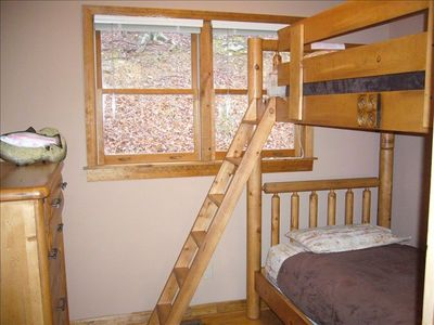 Comfortable log-style bunk beds in 3rd bedroom