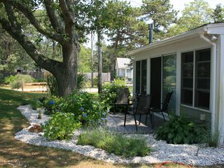 West Yarmouth cottage photo - Relax on the new private back deck surrounded by plants and crushed shells