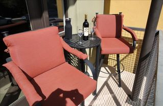 Seating for two by the front entrance. - Phoenix townhome vacation rental photo