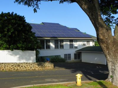 Wailuku GUesthouse exterior showing our photovoltaic solar system.