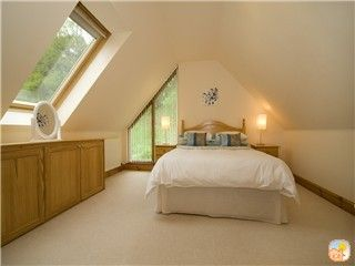 one of the 5 spacious bedrooms in Farmhouse