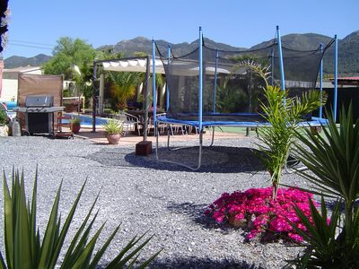 5,000M2 Gated Grounds to Villa With Tropical Plants, Giant Trampoline, Gas BBQ