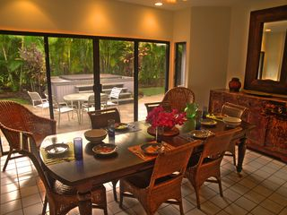 Poipu house photo - Large comfortable dining room opens to outdoor dining and hot tub