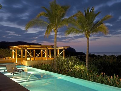 Three pools overlooking the ocean and garden leading down to a private beach.