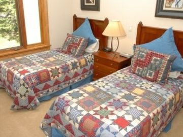 The third bedroom is perfect for two children or adults. It has two twin beds and a large window.