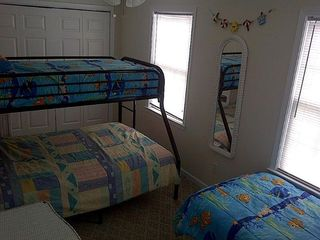 Middle bedroom. Picture shows bunk with double on bottom, single on top. - Wildwood condo vacation rental photo