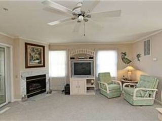 North Ocean City townhome photo - View of TV and gas fireplace from couch; the conversation nook is to the right.