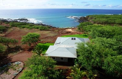 Newer house on 5 acres with small cove and sand beach