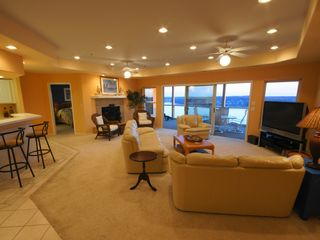 Lake Ozark condo photo - You'll love the spacious living area and HDTV if you're not watching the Lake!