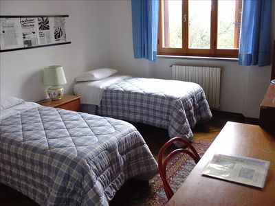 A bed-room of the Apt 1 (Large Apartment) with 2 sleeps (2 single beds)