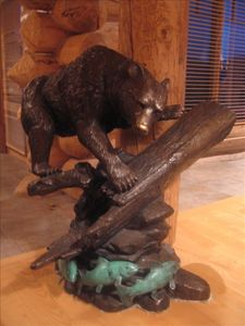 Bronze bear sculpture in great room