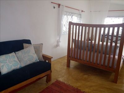 Upstairs with queen bed, double futon for sitting or extra sleeping area