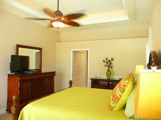 Cape Coral house photo - Master bedroom has tray ceiling with soffett lighting