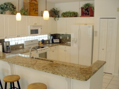 Sunset Lakes house rental - Full service kitchen with granite counters and new appliances
