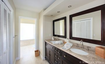 Plush Master Spa Bath with His & Her Vanities ...