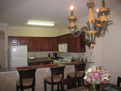 kitchen with Cherry Cabinets, Granite tops and breakfast bar.