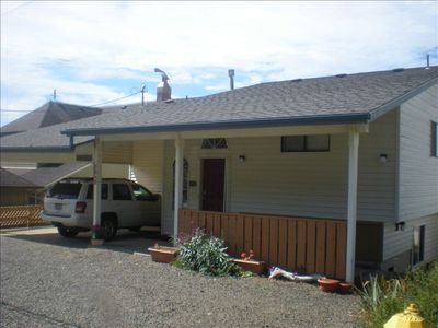 street side of house with open carport,  ample parking and covered gas bbq