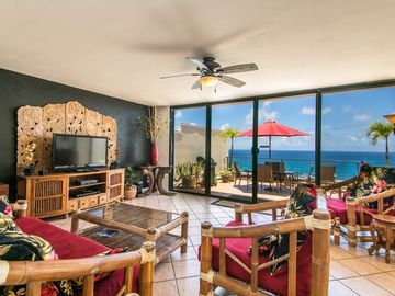 Princeville condo rental - Elegant, ocean front living room furnished with a fun, tasteful Indonesian flair