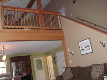 View of open stairway to second level loft and upper level bedroom !