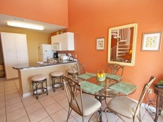 Orange Beach condo photo - Dining area with seating for four and three bar stools