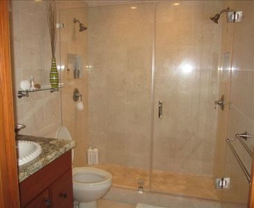 marble bath with dual shower heads