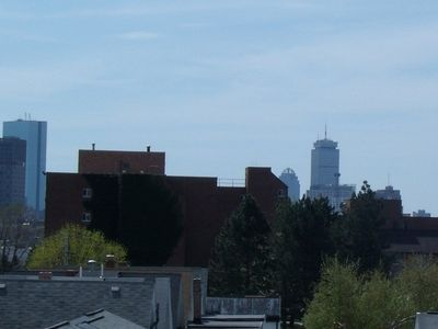 skyline view of Boston from rooftop deck