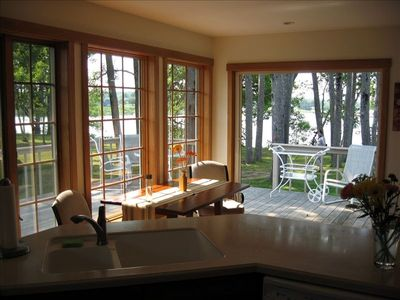 Kitchen view through double french doors to deck