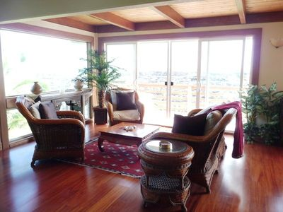 Kalapana house rental - Comfortable lounge chairs and sofa in living room creates indoor/outdoor feel