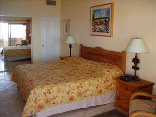 San Jose del Cabo condo photo - Spacious master bedroom with king-sized bed and pr