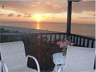Sanibel Island condo photo - Enjoy the morning sunrise up out of the Gulf while you have coffee on the lanai