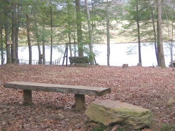 bench near cabin, looking down at the water