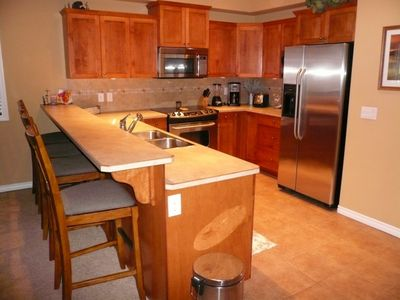 very open kitchen with upgraded stainless steel appliances