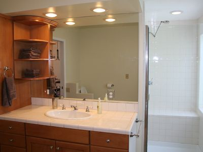 Our bathroom has an over sized shower, large vanity and plenty of storage.